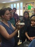 Dr. Kathryn Daltorio, CWRU researcher, shows a praying mantis to RRMS students.