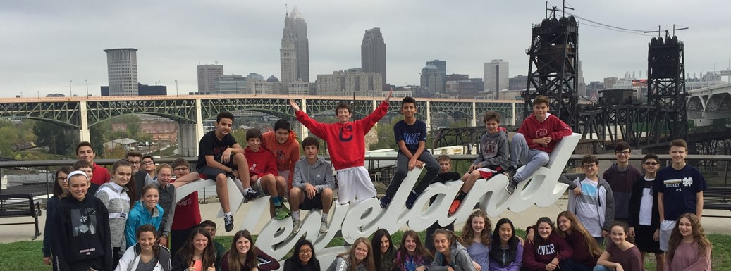 Students in front of Cleveland sign