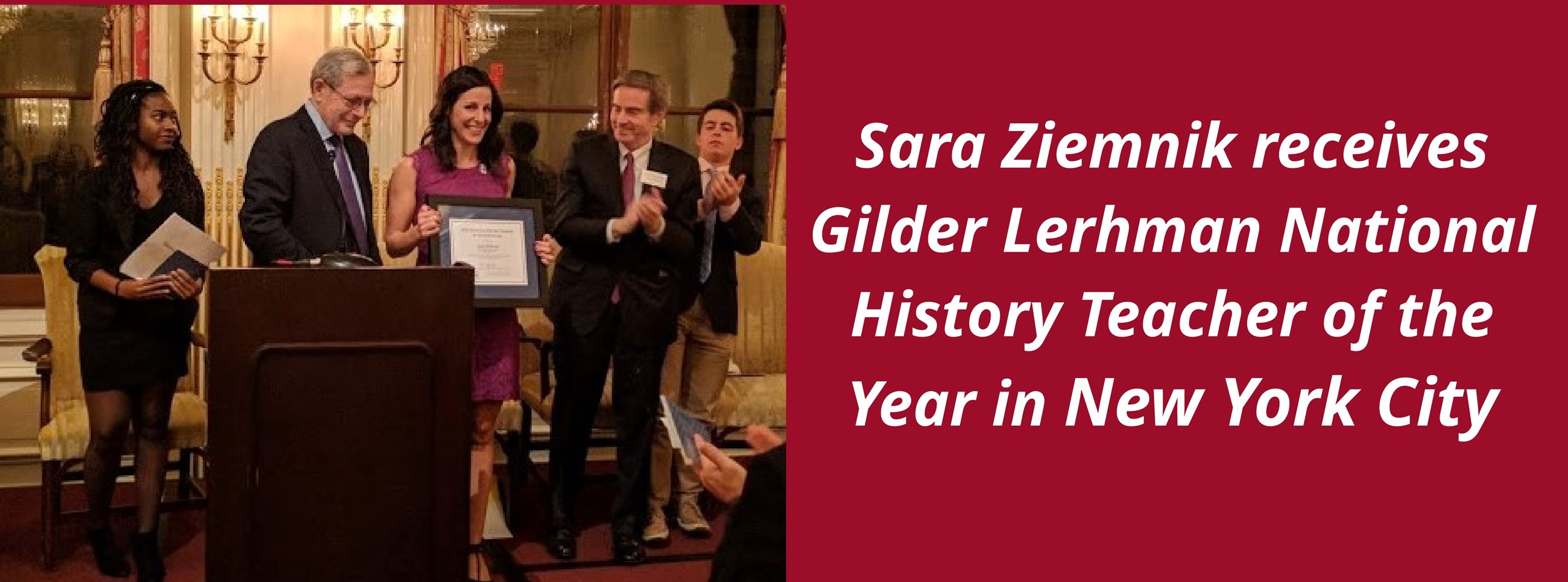 History Teacher Sara Ziemnik on stage with her award and four other by a podium