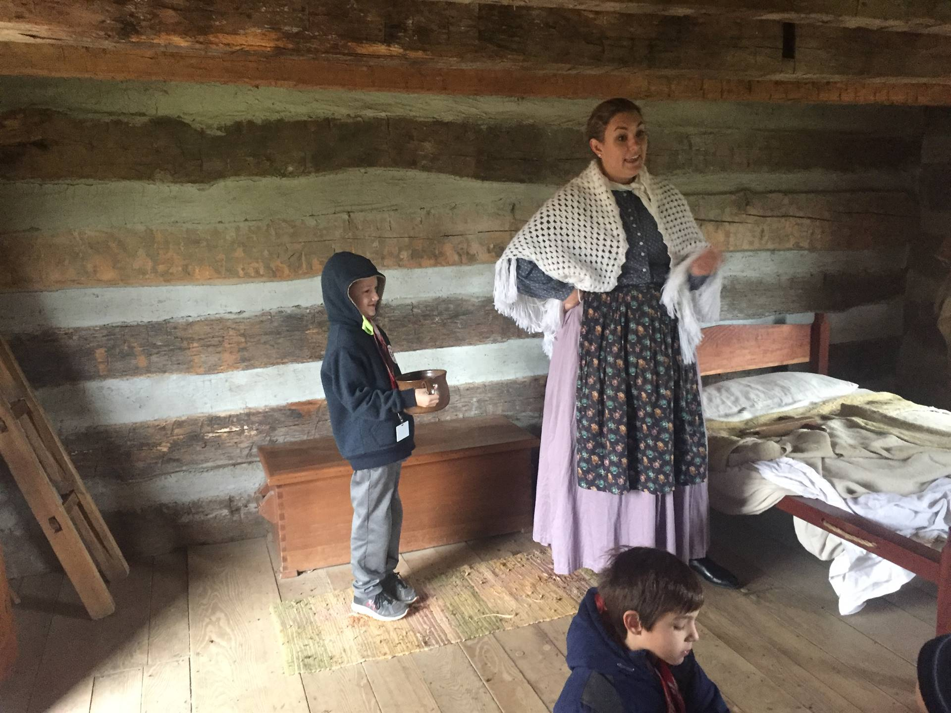 Students learning about the first settlement at Hale Farm