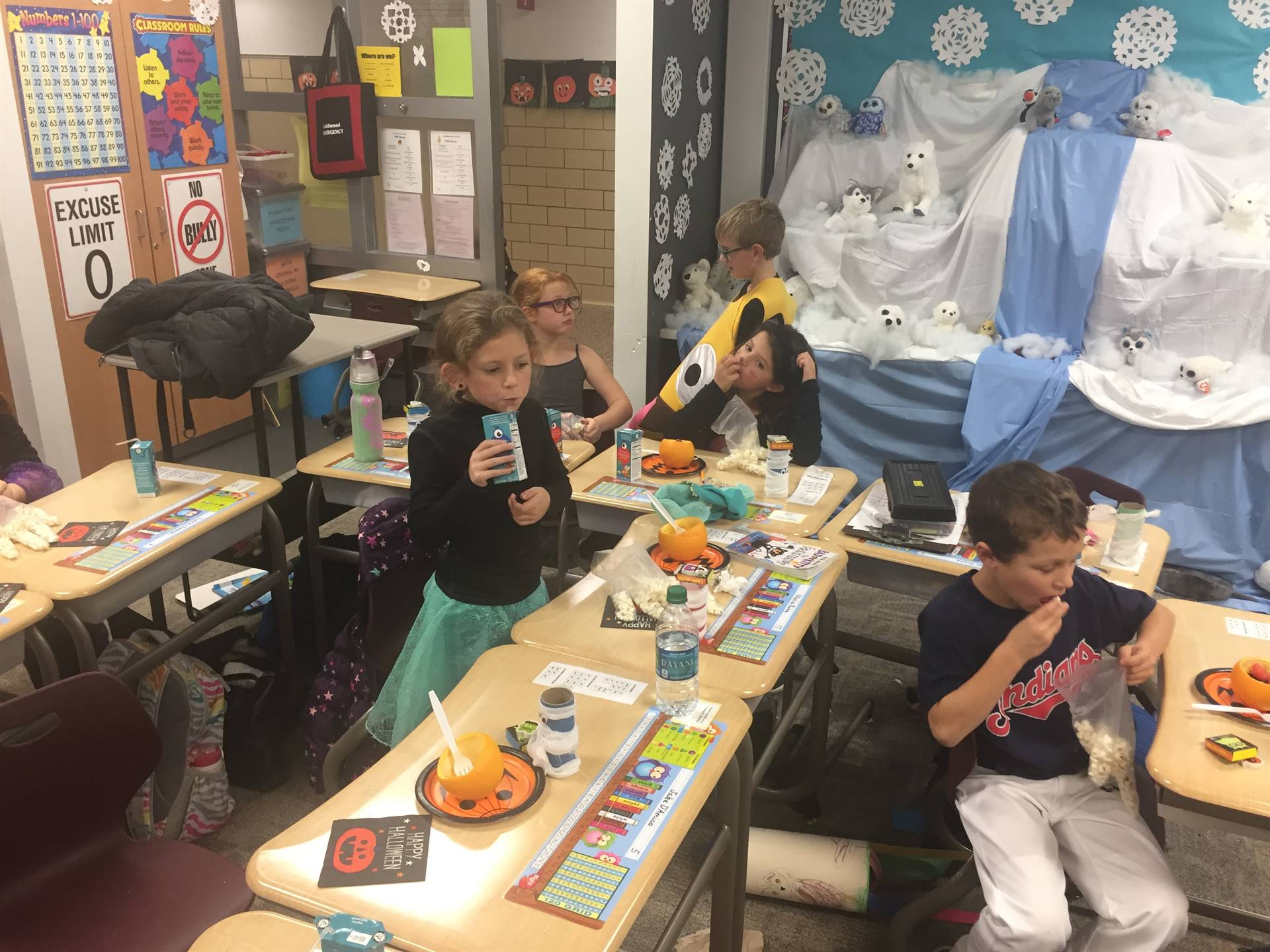 Students eating at Halloween party