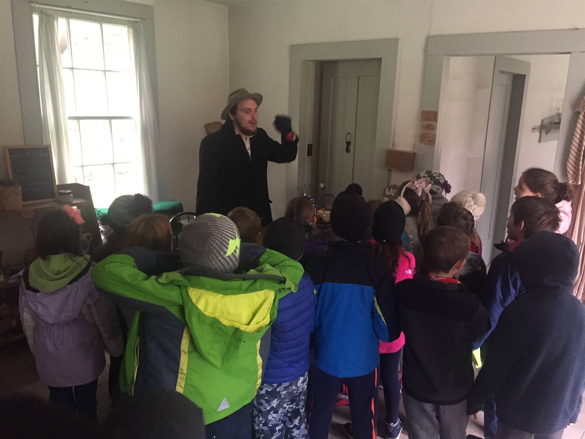 Students learning about what goes on at a General Store at Hale Farm