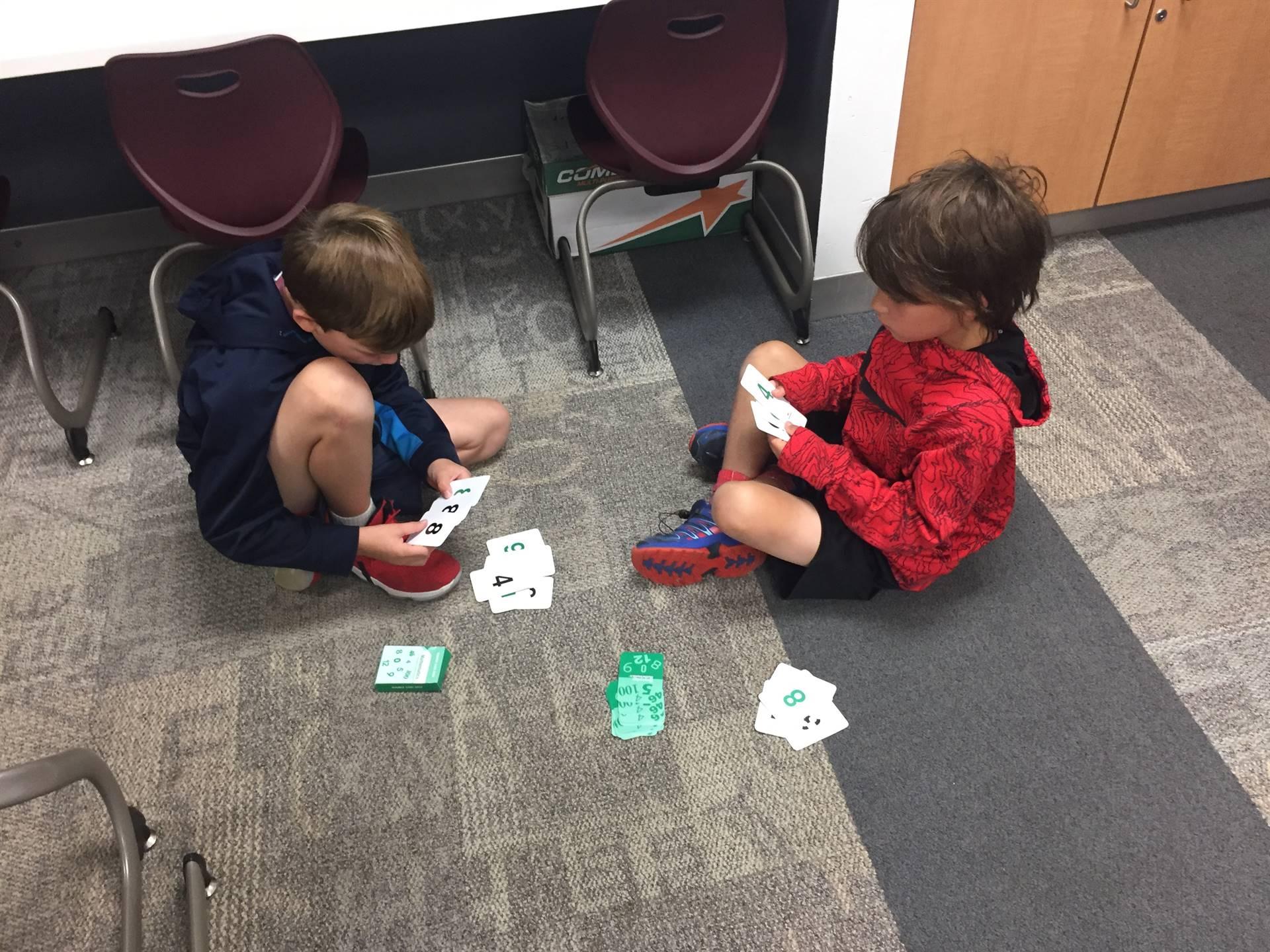 Kids playing math game fishing for ten