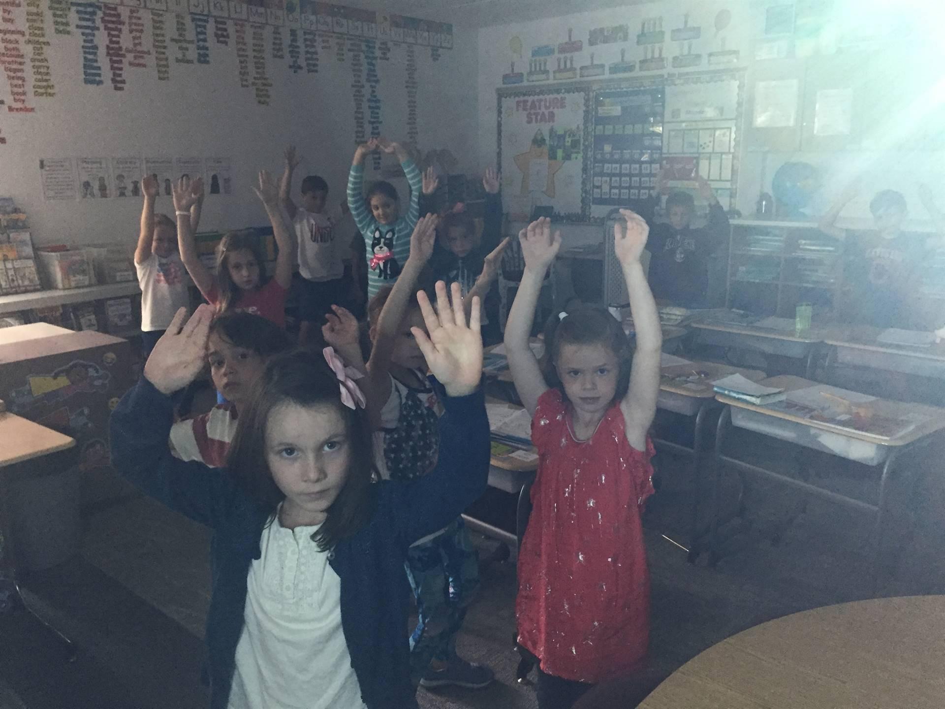 class doing yoga