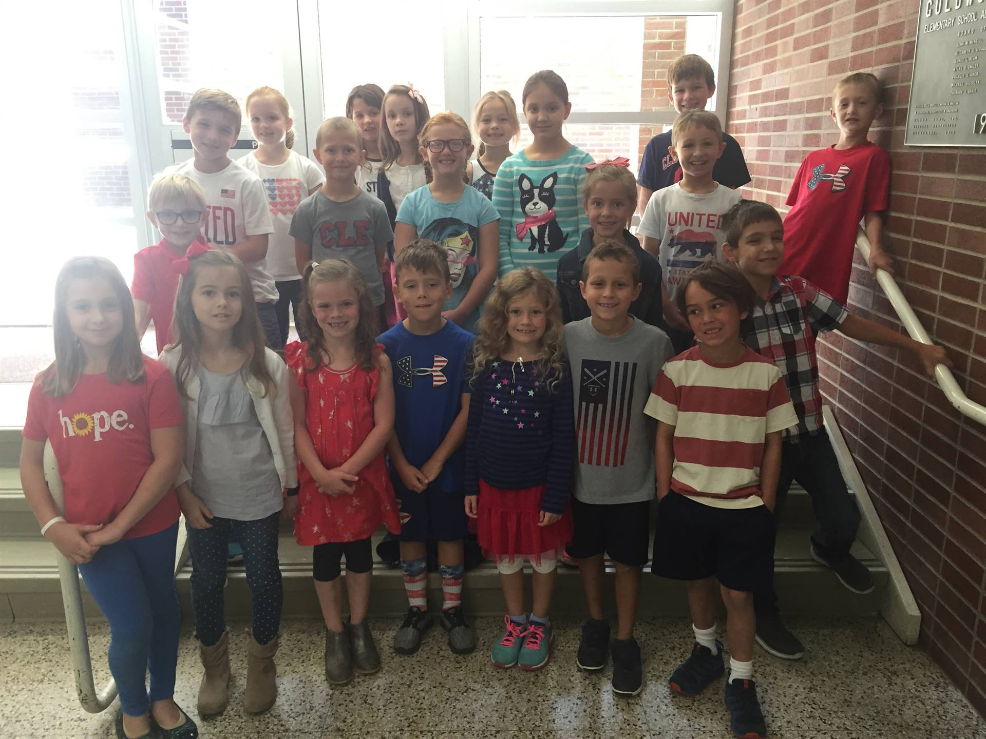 class posing for Patriot Day