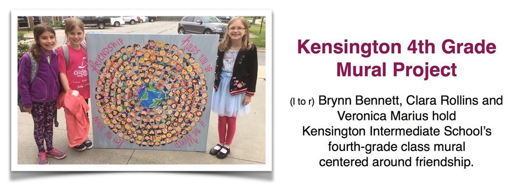 Brynn Bennett, Clara Rollins and Veronica Marius hold  Kensington Intermediate School's  fourth-grade class mural  centered around friendship.