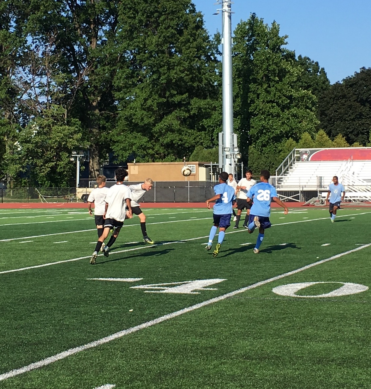 Nate Keeling heads the ball during the Benedictine scrimmage.