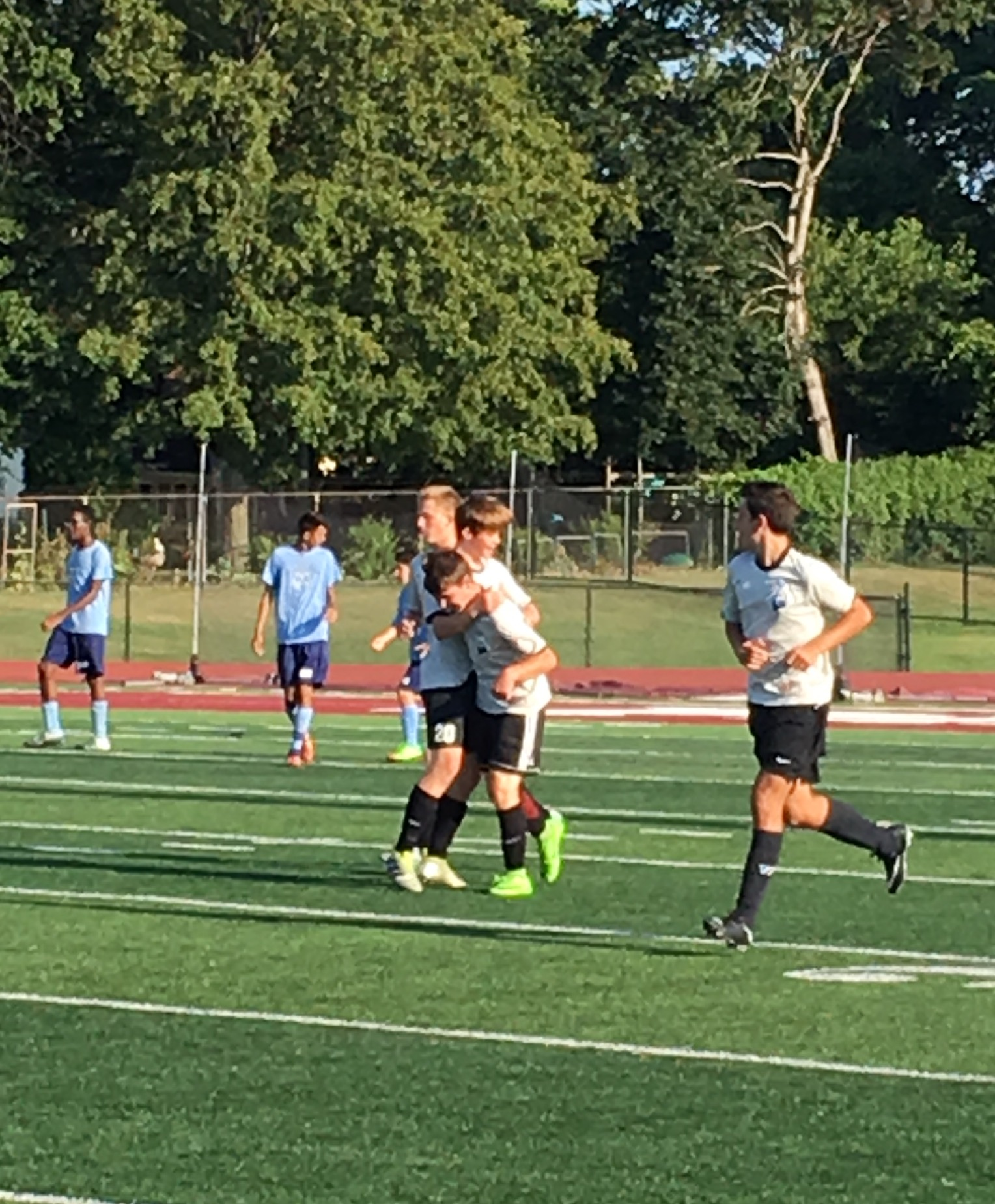 Conor McKenna gets congratulated after his goal in the Benedictine scrimmage.