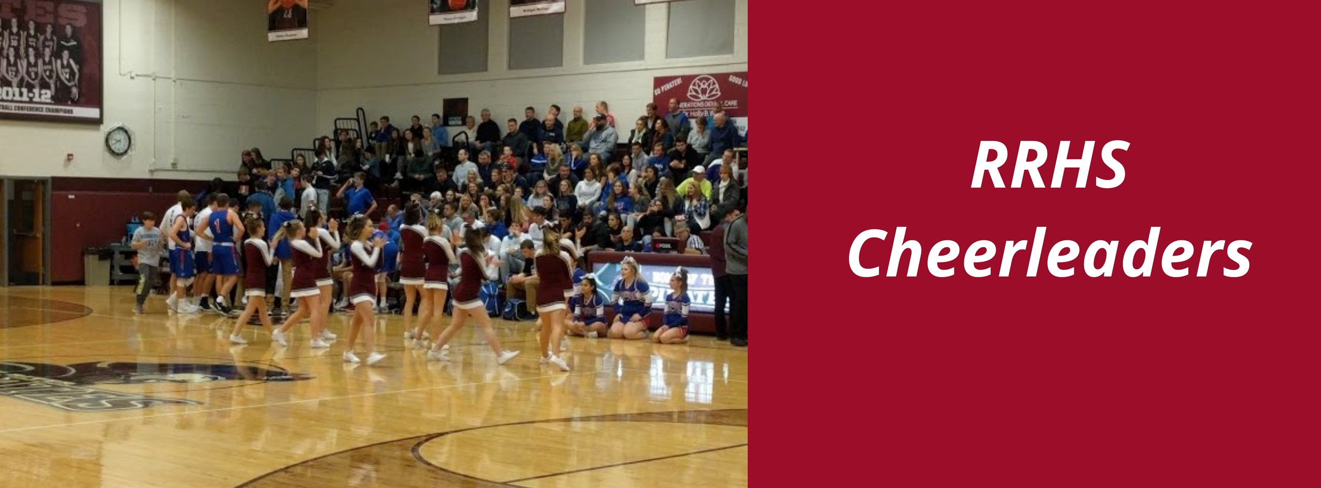 RRHS Cheerleaders doing a cheer on the gym court