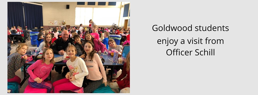Officer Schill sits with Goldwood Second Graders during lunch