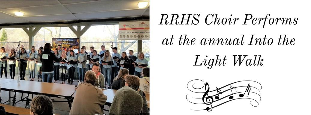 RRHS choir with teacher singing to audience