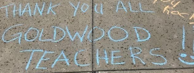 Students thanks teachers during teacher appreciation week with sidewalk chalk