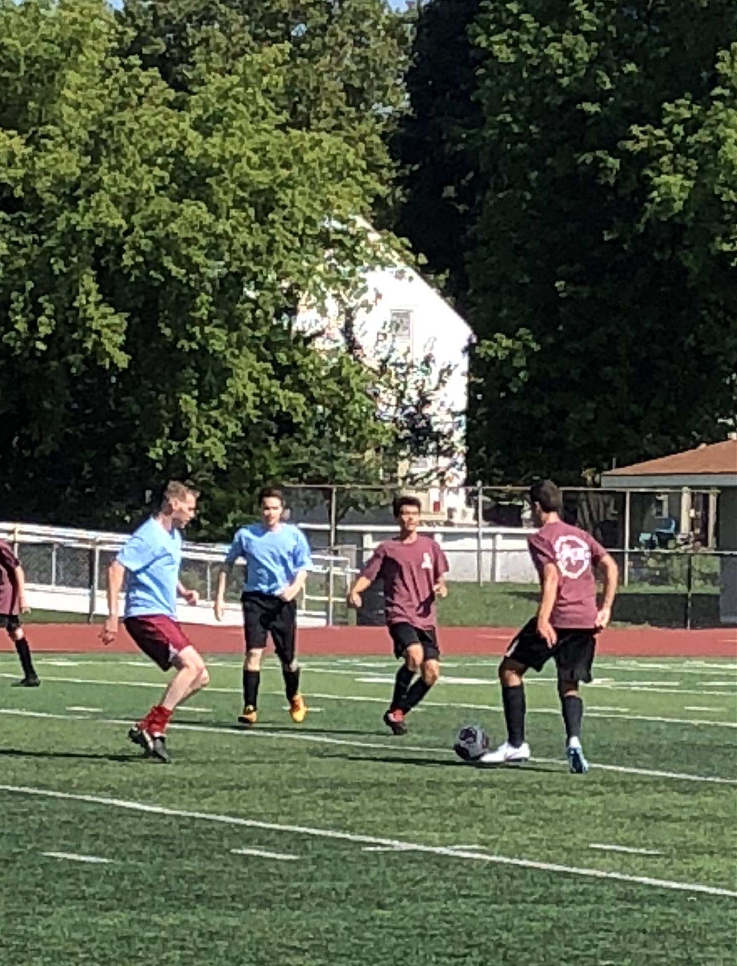 Junior Athan Tsigas and senior David Janke look to get the ball out of their offensive third.