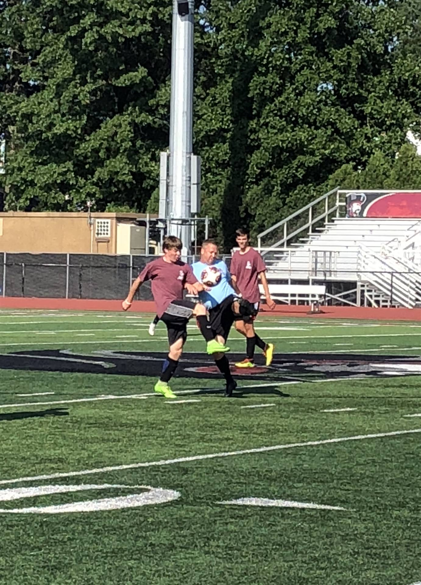 Taylor Haley, soccer senior class of 1992, fights for the ball with sophomore Conor McKenna.