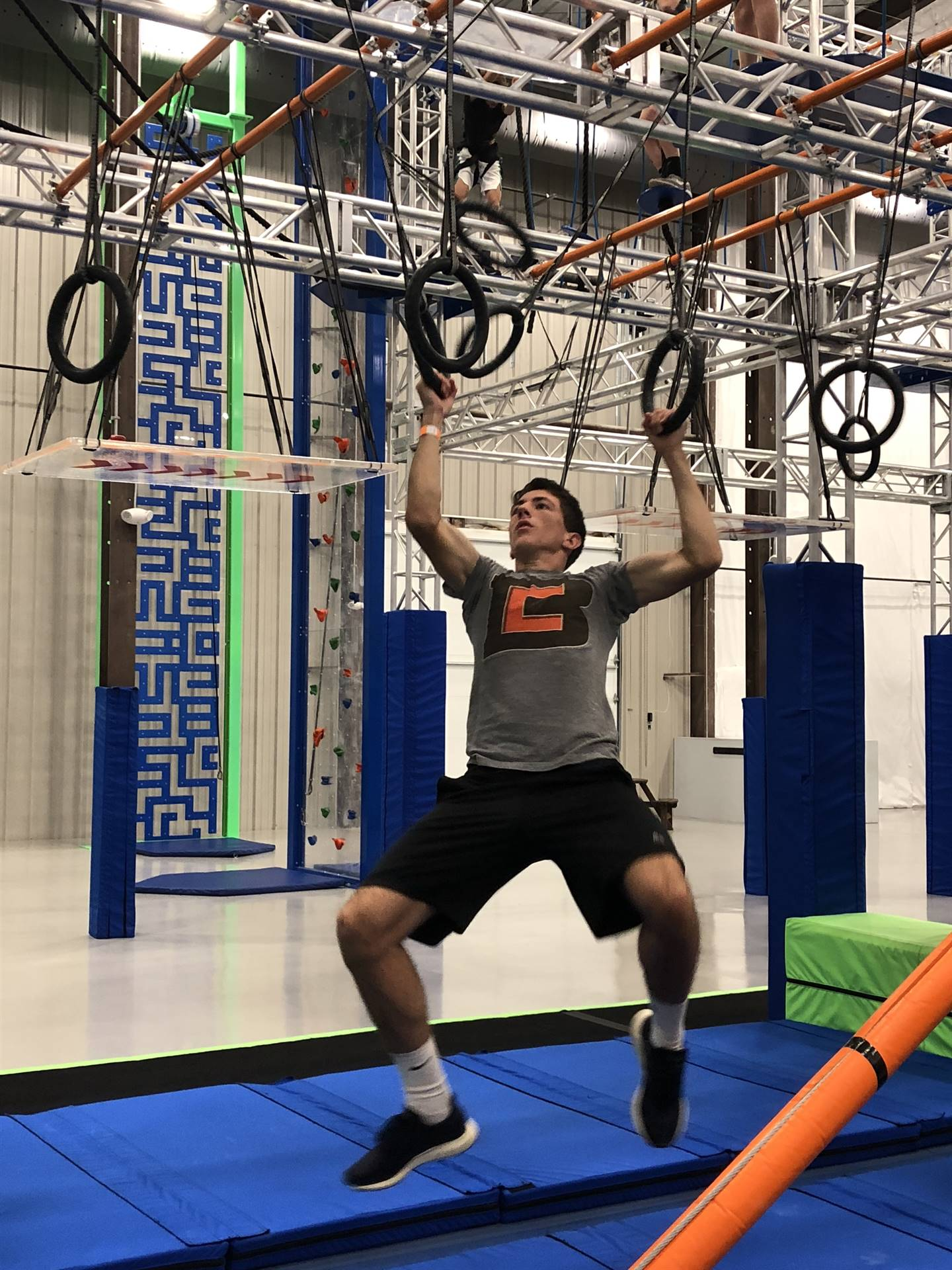 Junior John Ruebsteck getting after it on the rings.