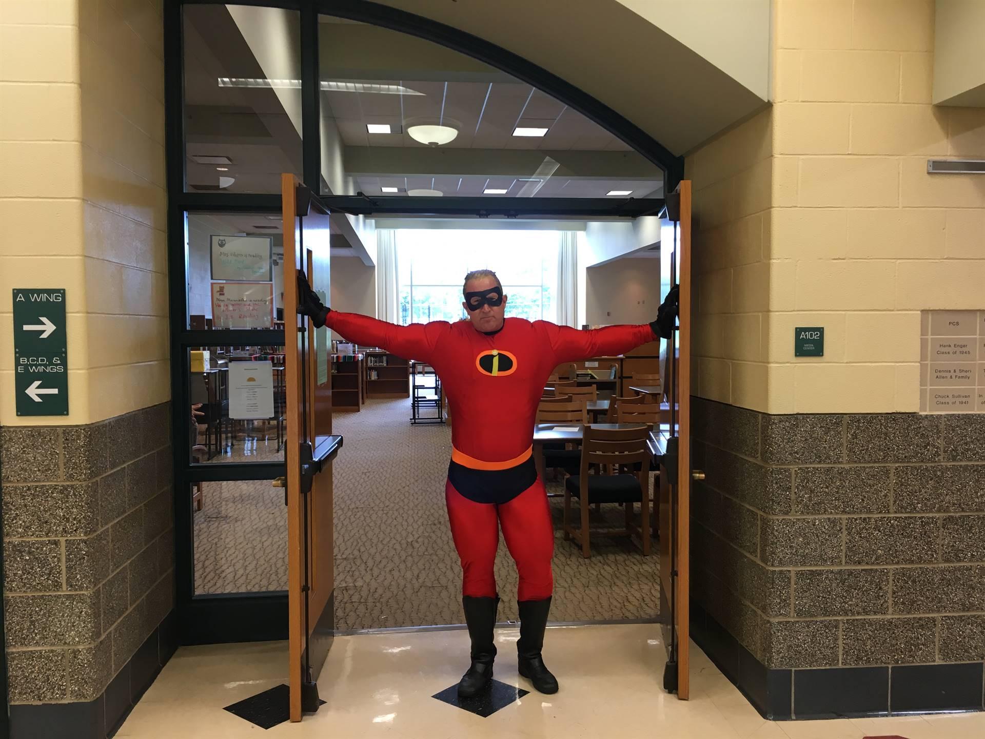 superhero entering library