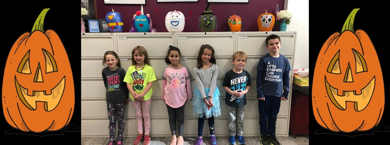 Winners of the PTA Pumpkin Raffle with their prizes!