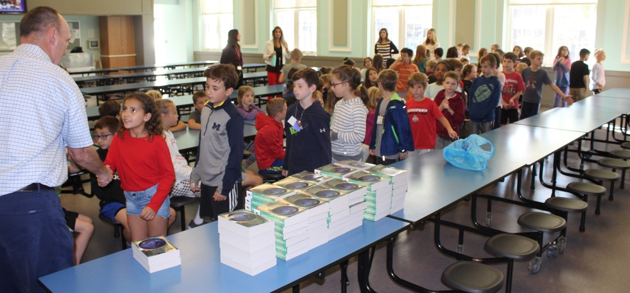 KIS Third grade dictionary donation from Rotary