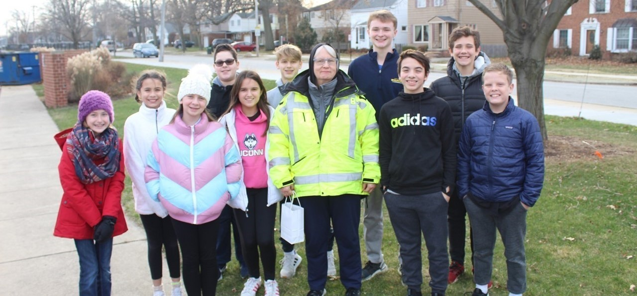 Student Council Members Present Gifts to Crossing Guards