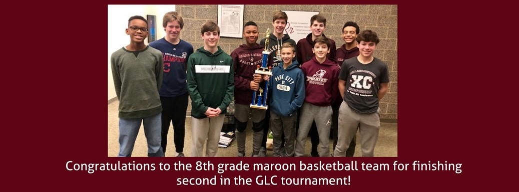 8th grade basketball team wins second place trophy
