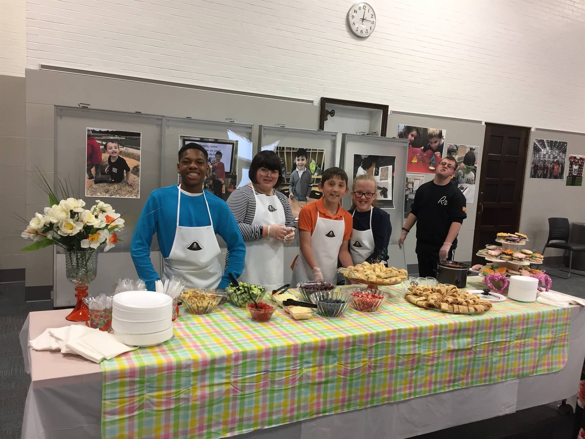 Middle School and High School Students Prepared, Presented and Served Food to Families!