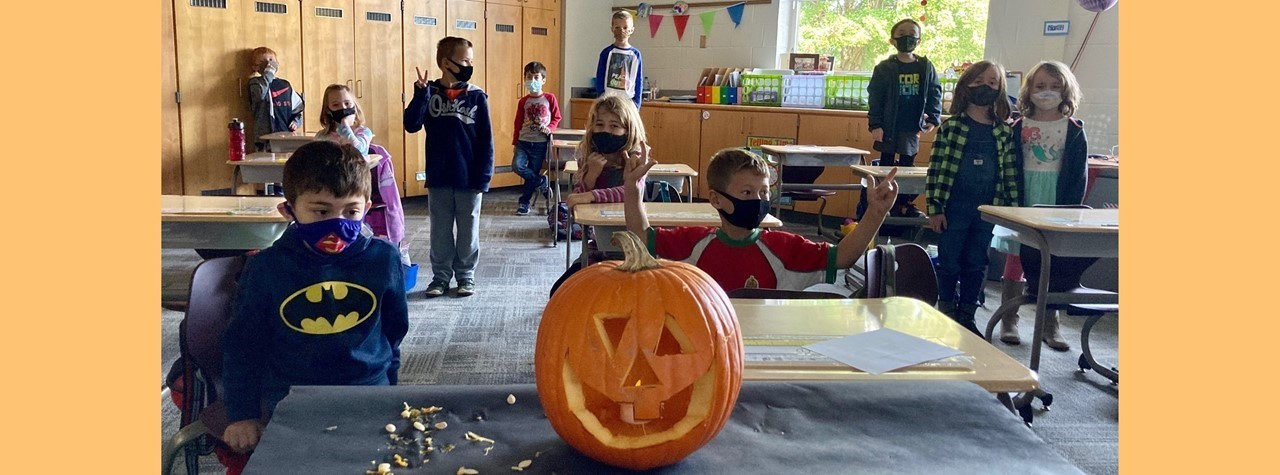 Mrs. Tarnai's class carved a pumpkin to prepare for their writing assignment