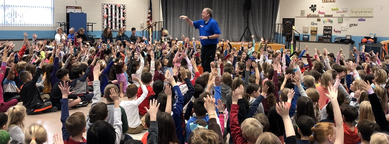 Students learn about spreading kindness during the Basketball Jones assembly.