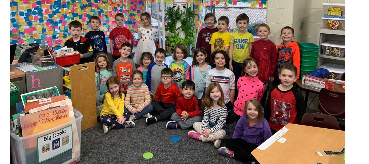 Ms. Henning's Kindergarten class proudly shows off the Tower Garden they received from a student's grandparents.