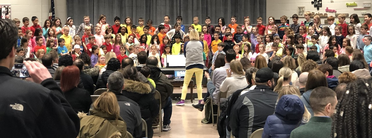 First Graders perform their musical program for their special guests.