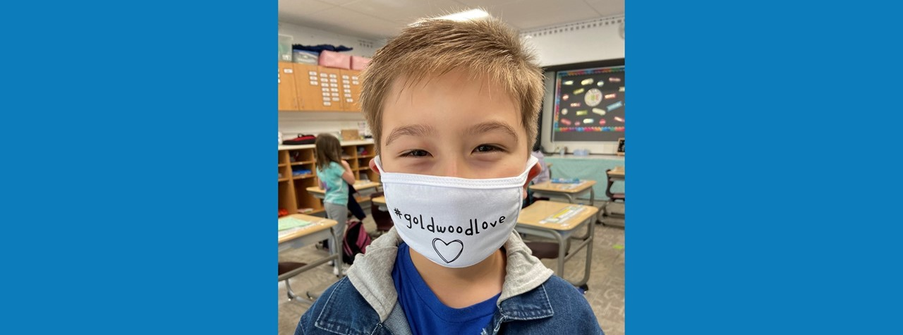 Student wearing a face mask that says #goldwoodlove