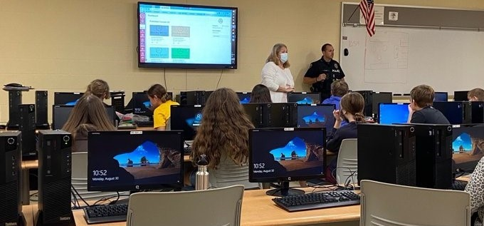 SRO Camp and Mrs. Rose Teach Technology Safety to 6th grade